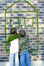Children-writing-on-brick-wall